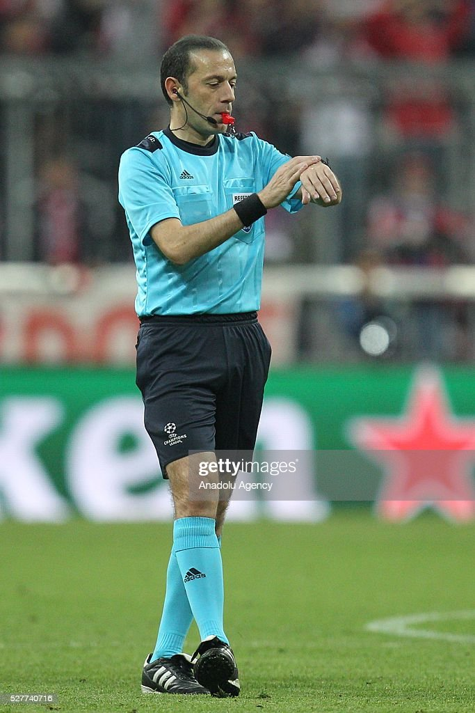 Referee Cuneyt Cakir looks at his watch as he conducts the UEFA Champions League semifinal second leg soccer match between FC Bayern Munich and Atletico Madrid at the Allianz Arena in Munich, Germany on May 3, 2016.
