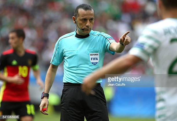 Referee Cuneyt Cakir of Turkey gestures during the UEFA EURO 2016 Group E match between Belgium and Republic of Ireland at Stade Matmut Atlantique on...