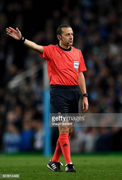 Referee Cuneyt Cakir of Turkey gives a decision during the UEFA Champions League Semi Final first leg match between Manchester City FC and Real...
