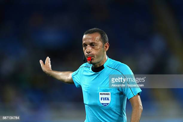 Referee Cuneyt Cakir reacts during the Men's Group D first round match between Argentina and Algeria during the Rio 2016 Olympic Games at the Olympic...
