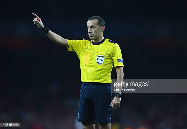 Referee Cuneyt Cakir signals during the UEFA Champions League Group F match between Arsenal FC and FC Bayern Munchen at Emirates Stadium on October...