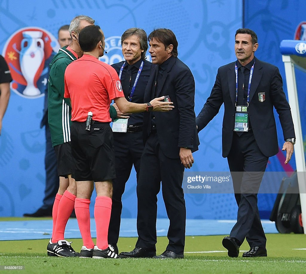 Referee Cuneyt Cakir talks to <a gi-track='captionPersonalityLinkClicked' href=/galleries/search?phrase=Antonio+Conte&family=editorial&specificpeople=2379002 ng-click='$event.stopPropagation()'>Antonio Conte</a> head coach of Italy during the UEFA EURO 2016 round of 16 match between Italy and Spain at Stade de France on June 27, 2016 in Paris, France.