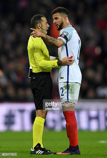 Referee Cuneyt Cakir talks to Kyle Walker of England during the FIFA 2018 World Cup qualifying match between England and Scotland at Wembley Stadium...