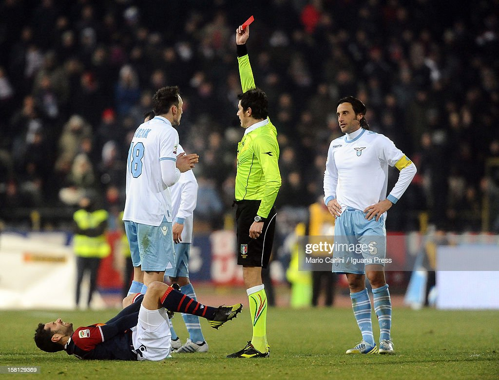 Referee Damato ( R ) shows a red car to Libor Kozak # 18 of SS Lazio ( L ) during the Serie A match between Bologna FC and S.S. Lazio at Stadio Renato Dall'Ara on December 10, 2012 in Bologna, Italy.