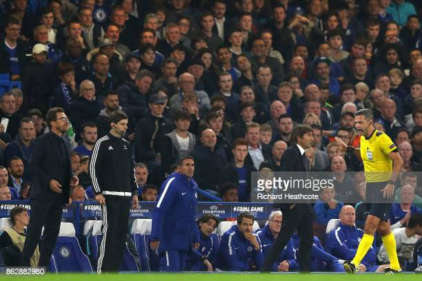 Referee Damir Skomina argues with Antonio Conte Manager of Chelsea during the UEFA Champions League group C match between Chelsea FC and AS Roma at...