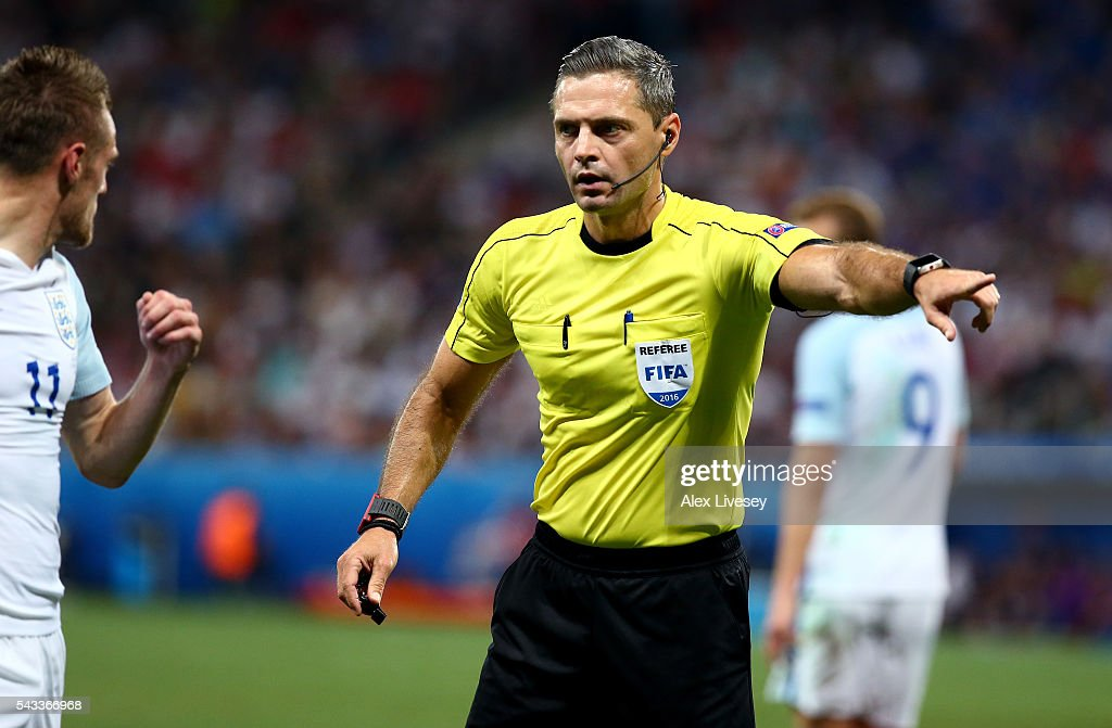 Referee <a gi-track='captionPersonalityLinkClicked' href=/galleries/search?phrase=Damir+Skomina&family=editorial&specificpeople=4333162 ng-click='$event.stopPropagation()'>Damir Skomina</a> gestuers during the UEFA EURO 2016 round of 16 match between England and Iceland at Allianz Riviera Stadium on June 27, 2016 in Nice, France.