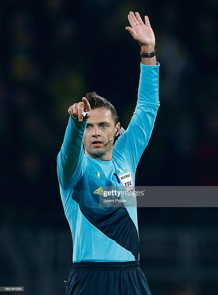 Referee Damir Skomina gestures during the UEFA Champions League round of 16 leg match between Borussia Dortmund and Shakhtar Donetsk at Signal Iduna Park on March 5, 2013 in Dortmund, Germany.