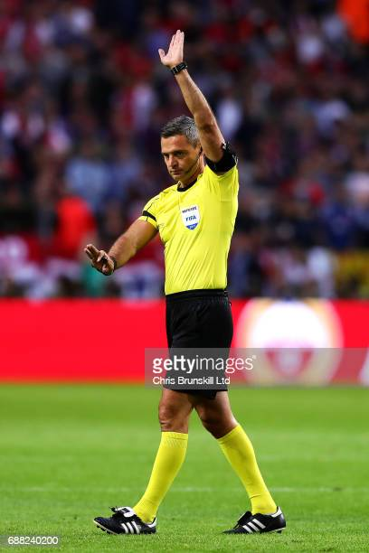 Referee Damir Skomina gestures during the UEFA Europa League Final match between Ajax and Manchester United at Friends Arena on May 24 2017 in...