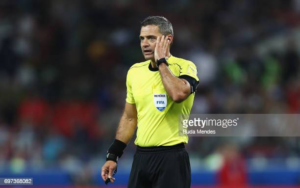 Referee Damir Skomina waits to hear the decision on the second Chile goal during the FIFA Confederations Cup Russia 2017 Group B match between...