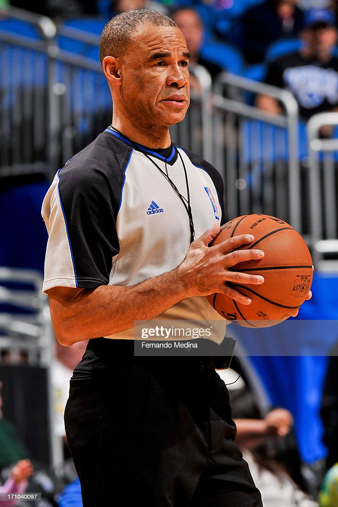 Referee Dan Crawford #43 prepares to officiate a game between the Washington Wizards and Orlando Magic on December 19, 2012 at Amway Center in Orlando, Florida.
