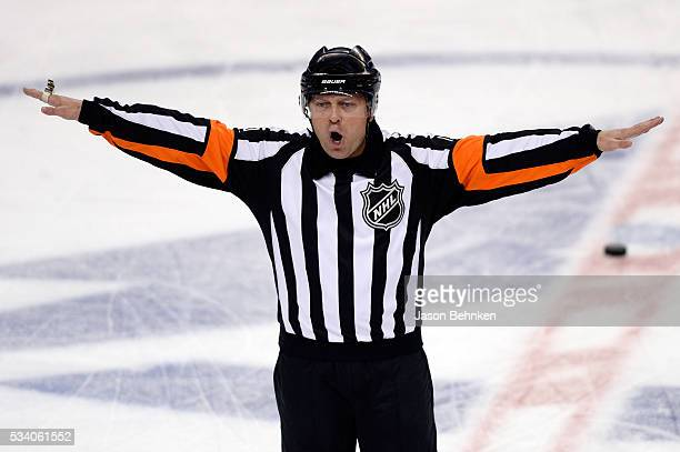 Referee Dan O'Halloran disallows a goal attempted by Jonathan Drouin of the Tampa Bay Lightning during the first period against the Pittsburgh...