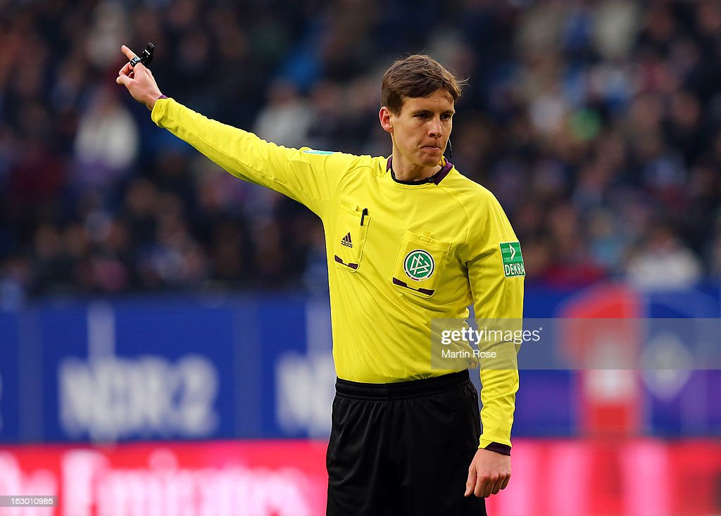 Referee Daniel Siebert gestures on during the Bundesliga match between Hamburger SV and Greuther Fuert at Imtech Arena on March 2, 2013 in Hamburg, Germany.