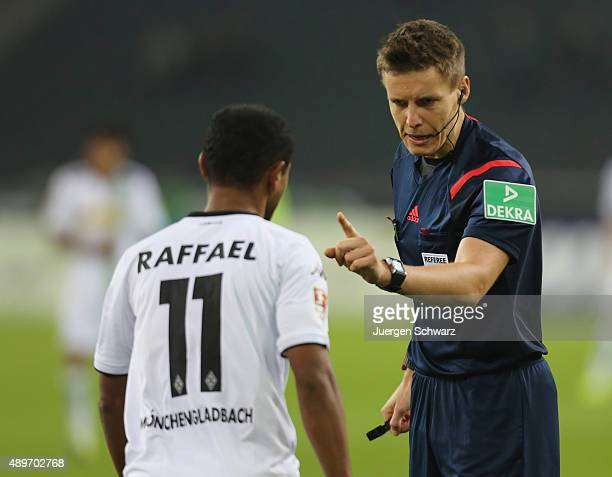 Referee Daniel Siebert instructs Raffael of Moenchengladbach during the Bundesliga match between Borussia Moenchengladbach and FC Augsburg at...