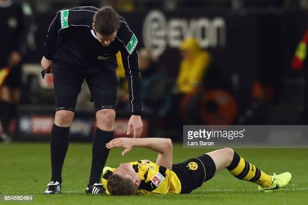 Referee Daniel Siebert looks after Matthias Ginter of Dortmund during the Bundesliga match between Borussia Dortmund and FC Ingolstadt 04 at Signal...