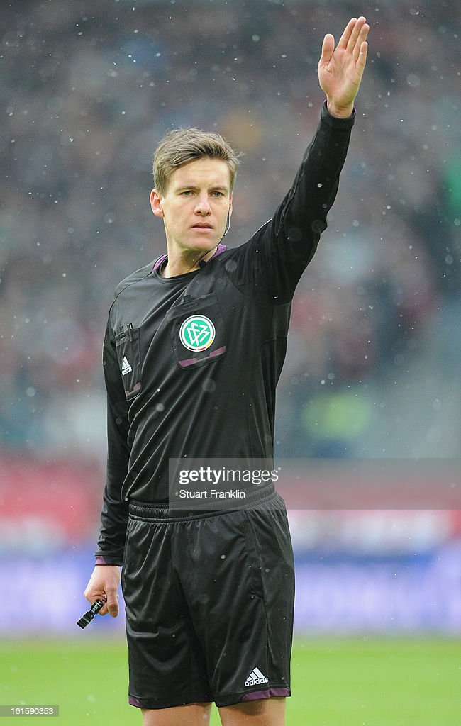Referee Daniel Siebert ponders during the Bundesliga match between Hannover 96 and TSG 1899 Hoffenheim at AWD Arena on February 9, 2013 in Hannover, Germany.