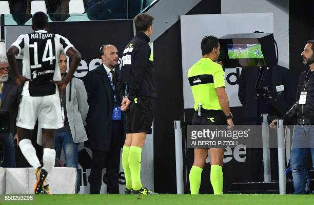 Referee Daniele Doveri checks the VAR during the Italian Serie A football match Juventus vs Fiorentina on September 20 2017 at Allianz stadium in...
