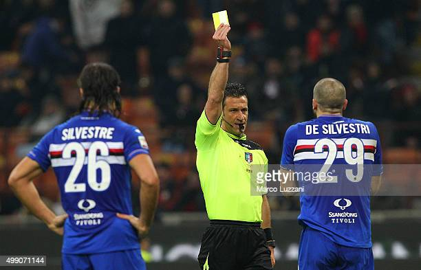 Referee Daniele Doveri shows the yellow card to Lorenzo De Silvestri of UC Sampdoria during the Serie A match between AC Milan and UC Sampdoria at...