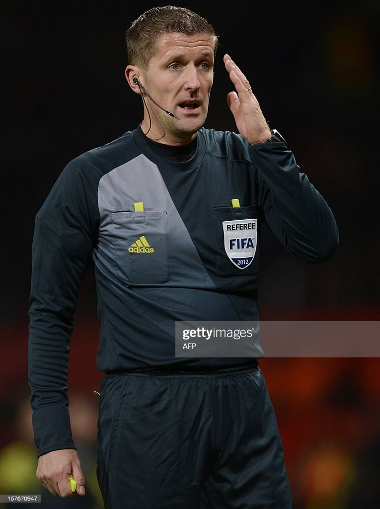 Referee Daniele Orsato of Italy looks on during the UEFA Champions League group H football match between Manchester United and CFR Cluj-Napoca at Old Trafford in Manchester, north-west England, on December 5, 2012. CFR Cluj-Napoca won 1-0.