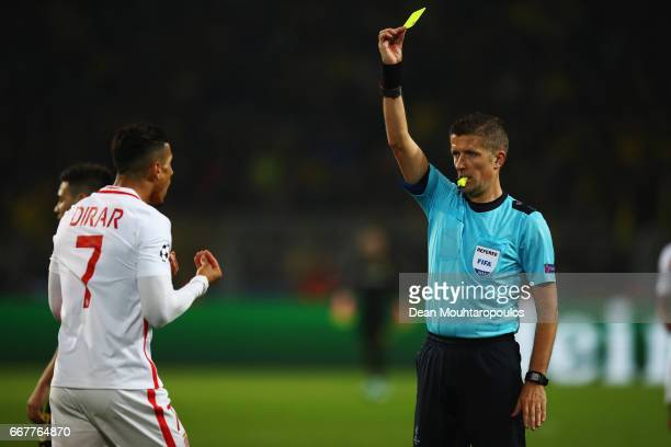 Referee Daniele Orsato shows Nabil Dirar of AS Monaco a yellow card during the UEFA Champions League Quarter Final first leg match between Borussia...