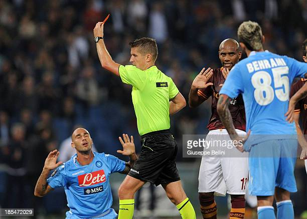 Referee Daniele Orsato shows the red card to Paolo Cannavaro of Napoli during the Serie A match between AS Roma and SSC Napoli at Stadio Olimpico on...