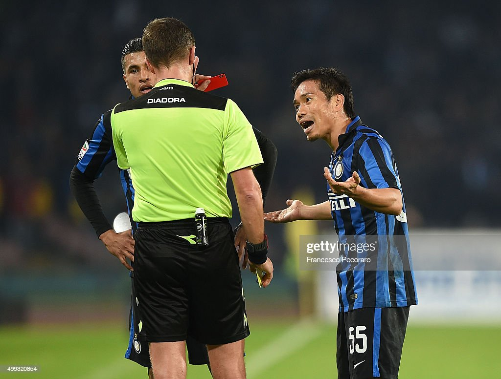 Referee Daniele Orsato shows the red card to Yuto Nagatomo during the Serie A match between SSC Napoli and FC Internazionale Milano at Stadio San Paolo on November 30, 2015 in Naples, Italy.