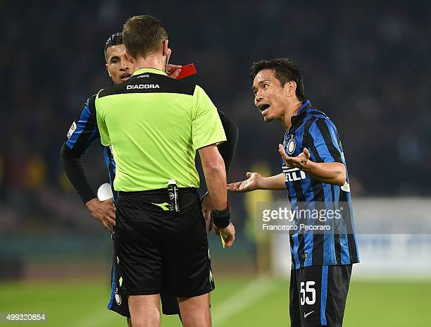 Referee Daniele Orsato shows the red card to Yuto Nagatomo during the Serie A match between SSC Napoli and FC Internazionale Milano at Stadio San...