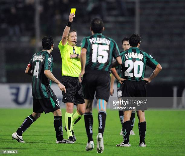 Referee Daniele Orsato shows the yellow card to Massimiliano Fusani of Sassuolo Calcio during the Serie B match between Ancona and Sassuolo at Del...