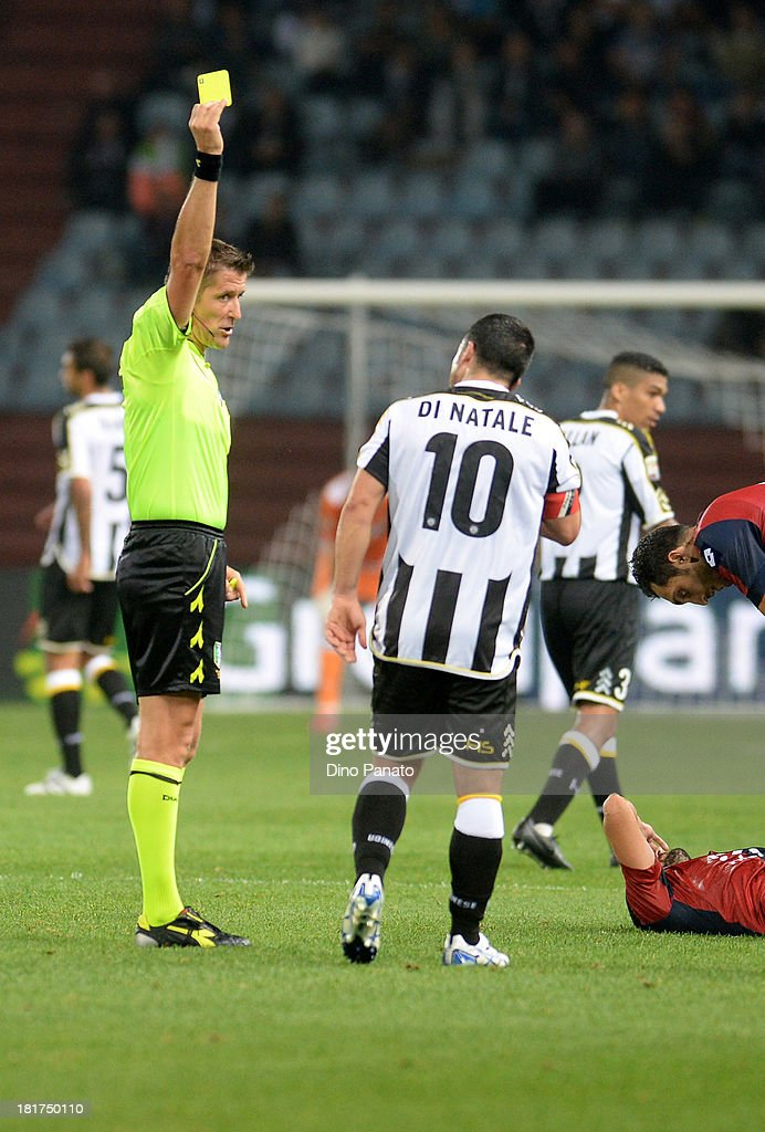 Referee Daniele Orsato (L) shows yellow card to Antonio Di Natale of Udinese Calcio during the Serie A match between Udinese Calcio and Genoa CFC at Stadio Friuli on September 24, 2013 in Udine, Italy.