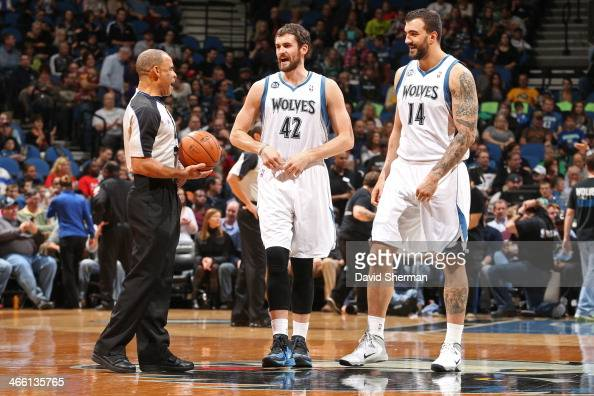 Referee Danny Crawford and Kevin Love and Nikola Pekovic of the Minnesota Timberwolves talk before the game against the Boston Celtics on November 16...