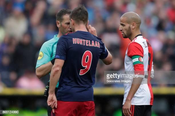 referee Danny Makkelie Klaas Jan Huntelaar of Ajax Karim El Ahmadi of Feyenoord during the Dutch Eredivisie match between Feyenoord v Ajax at the...