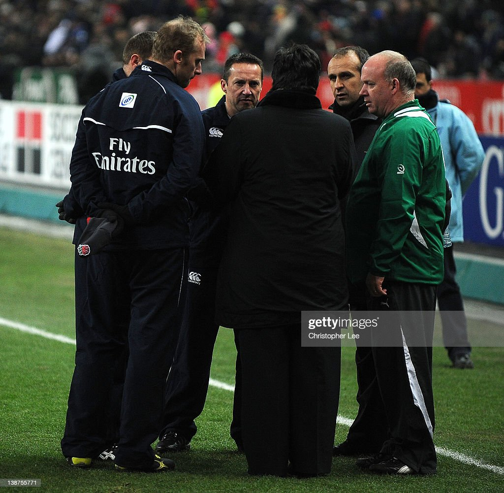 Referee Dave Pearson, France Coach Philippe Saint Andre and Ireland Coach Declan Kidney talk just before kick off during the RBS 6 Nations match between France and Ireland at Stade de France on February 11, 2012 in Paris, France.