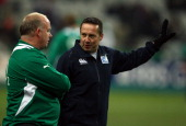 Referee Dave Pearson speaks Ireland coach Declan Kidney as the match is called off just before kick off due to a frozen pitch during the RBS 6...