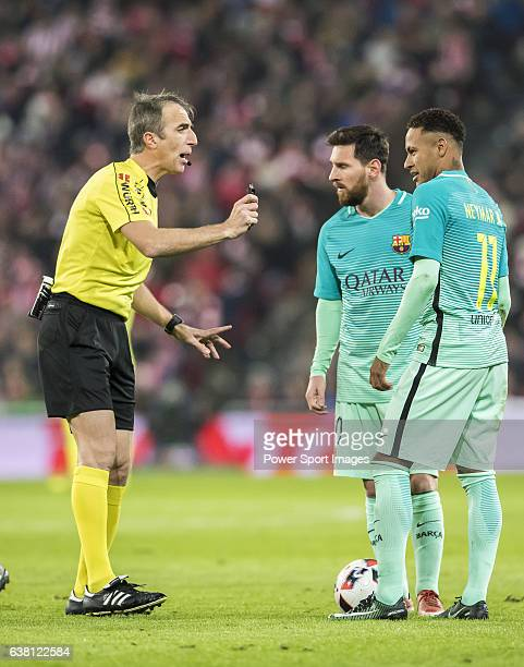 Referee David Fernandez Borbalan talks with Lionel Andres Messi and Neymar da Silva Santos Junior of FC Barcelona during their Copa del Rey Round of...