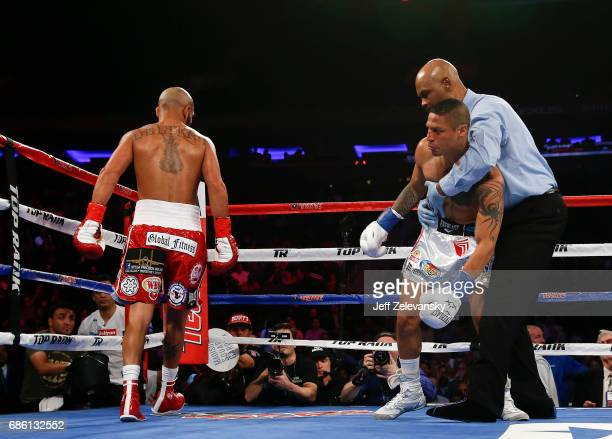 Referee David Fields holds up Jonathan Maicelo after the bell ending the first round against Raymundo Beltran during their IBF lightweight eliminator...