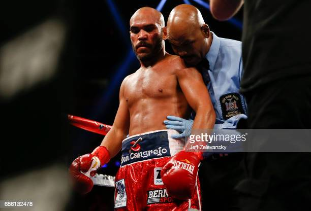 Referee David Fields talks with Raymundo Beltran after his knockout of Jonathan Maicelo during their IBF lightweight eliminator bout at Madison...