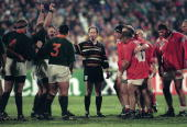 Referee David McHugh holds the two front rows apart during a Rugby World Cup match between Canada and South Africa in Port Elizabeth 3rd June 1995...