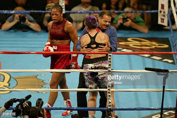 Referee David Mendoza stops the fight as Laila Ali walks away with the victory over Valerie Mahfood in the women's super middleweight bout at the...