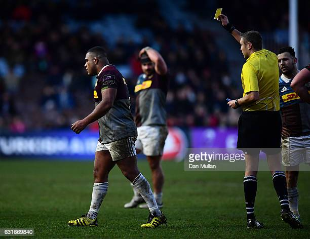 Referee David Wilkinson shows Kyle Sinckler of Harlequins a yellow card for an off the ball tackle on Magnus Bradbury of Edinburgh during the...