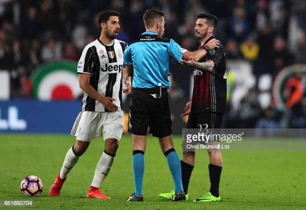 Referee Davide Massa shows Jose Sosa of AC Milan a red card during the Serie A match between Juventus FC and AC Milan at Juventus Stadium on March 10...