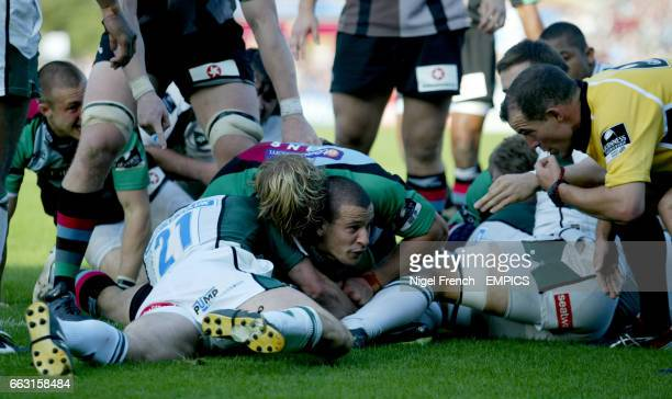 Referee Dean Richards gives Harlequins' Danny Care the try against London Irish