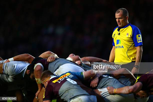 Referee Dean Richards instructs players during a scrum in the Aviva Premiership match between Harlequins and Bath Rugby at Twickenham Stoop on...