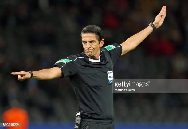 Referee Deniz Aytekin gestures during the Bundesliga match between Hertha BSC and Bayer 04 Leverkusen at Olympiastadion on September 20 2017 in...