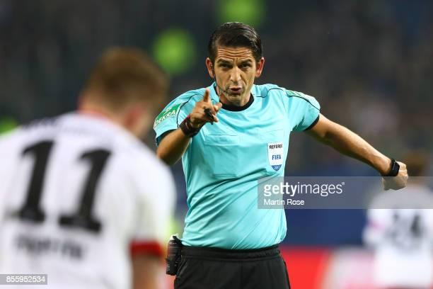 Referee Deniz Aytekin gestures during the Bundesliga match between Hamburger SV and SV Werder Bremen at Volksparkstadion on September 30 2017 in...