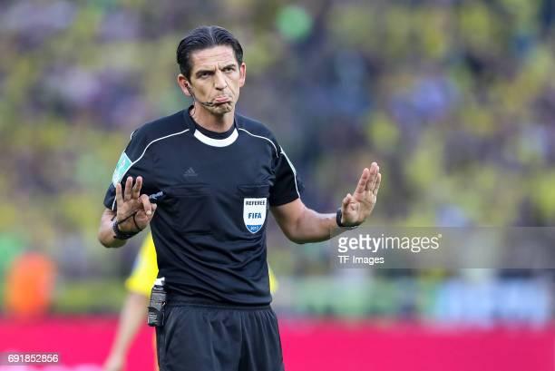 Referee Deniz Aytekin gestures during the DFB Cup final match between Eintracht Frankfurt and Borussia Dortmund at Olympiastadion on May 27 2017 in...