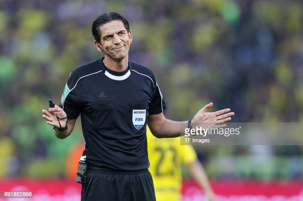 Referee Deniz Aytekin gestures during the DFB Cup final match between Eintracht Frankfurt and Borussia Dortmund at Olympiastadion on May 27 2017 in...