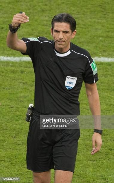 Referee Deniz Aytekin gestures during the German Cup final football match Eintracht Frankfurt v BVB Borussia Dortmund at the Olympic stadium in...