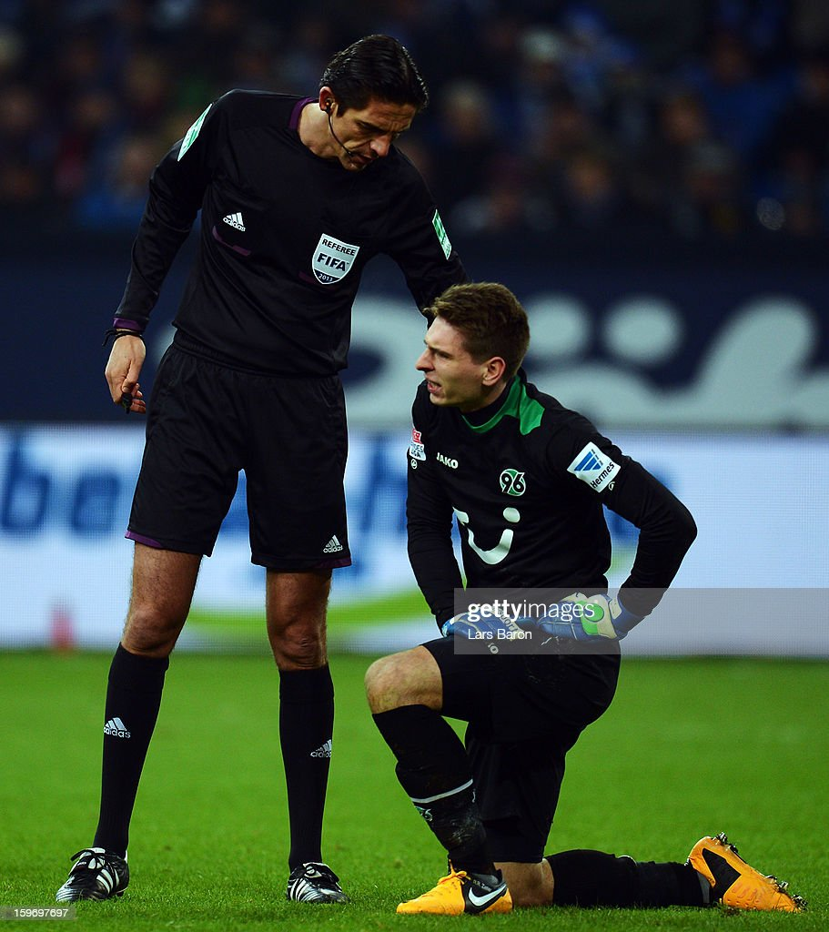 Referee Deniz Aytekin is seen with goalkeeper Ron Robert Zieler of Hannover during the Bundesliga match between FC Schalke 04 and Hannover 96 at Veltins-Arena on January 18, 2013 in Gelsenkirchen, Germany.