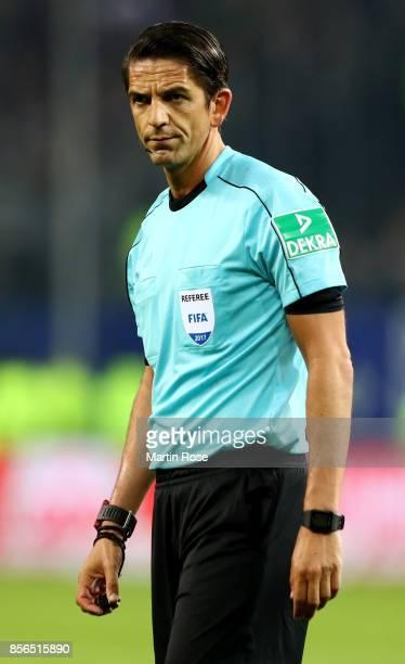Referee Deniz Aytekin looks on during the Bundesliga match between Hamburger SV and SV Werder Bremen at Volksparkstadion on September 30 2017 in...