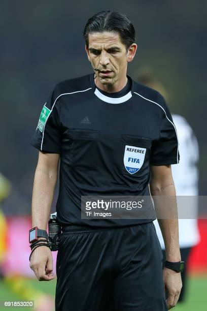 Referee Deniz Aytekin looks on during the DFB Cup final match between Eintracht Frankfurt and Borussia Dortmund at Olympiastadion on May 27 2017 in...