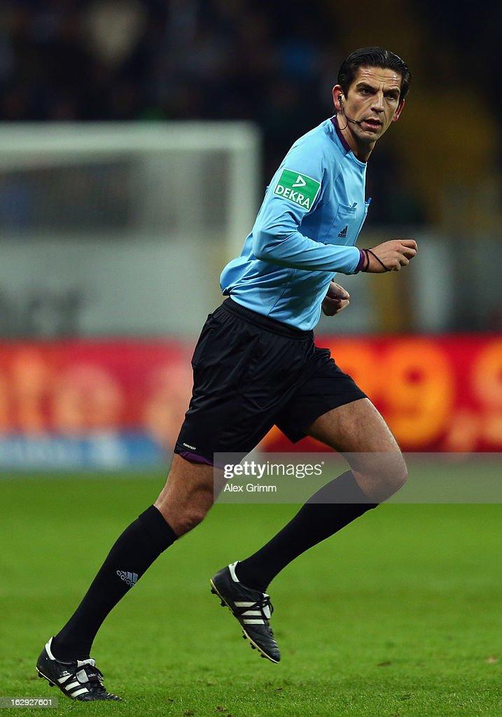 Referee Deniz Aytekin runs during the Bundesliga match between Eintracht Frankfurt and Borussia Moenchengladbach at Commerzbank-Arena on March 1, 2013 in Frankfurt am Main, Germany.